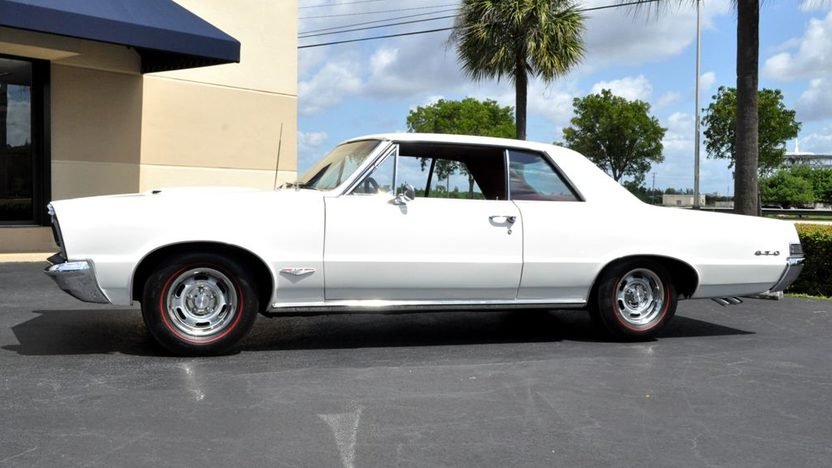 1965 Pontiac GTO 389/360 HP, 4-Speed presented as lot F219 at Kissimmee, FL 2013 - image2
