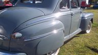 1946 Ford Deluxe Coupe presented as lot T145 at Kansas City, MO 2011 - thumbail image4