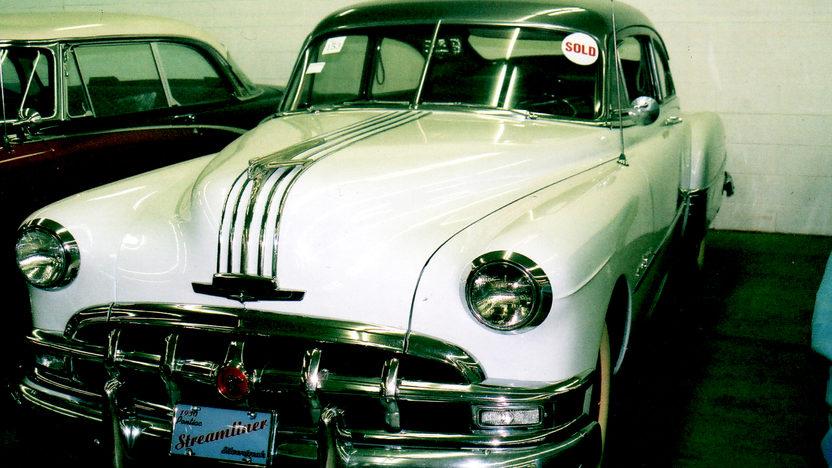 1950 Pontiac Streamliner 2-door Sedan presented as lot T124 at Indianapolis, IN 2009 - image2